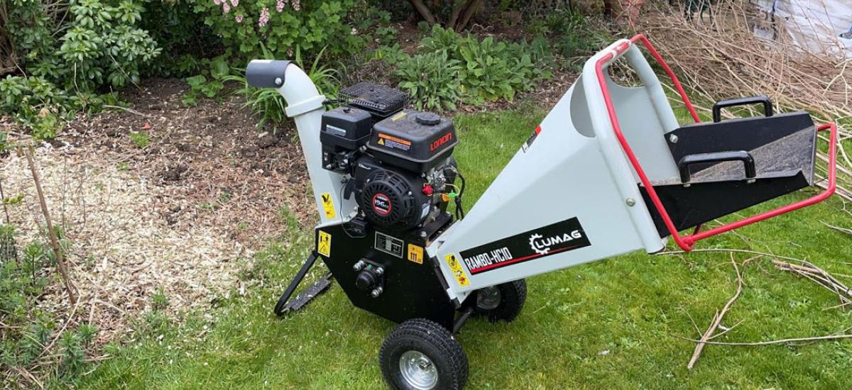 Hire a chipper to easily deal with small branches and trimmings around the garden
